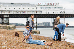 © Licensed to London News Pictures. 17/04/2017. Brighton, UK. Few people relaxes on the beach in Brighton as grey clouds hang over the seaside resort on the Easter bank holiday Monday. Photo credit: Hugo Michiels/LNP