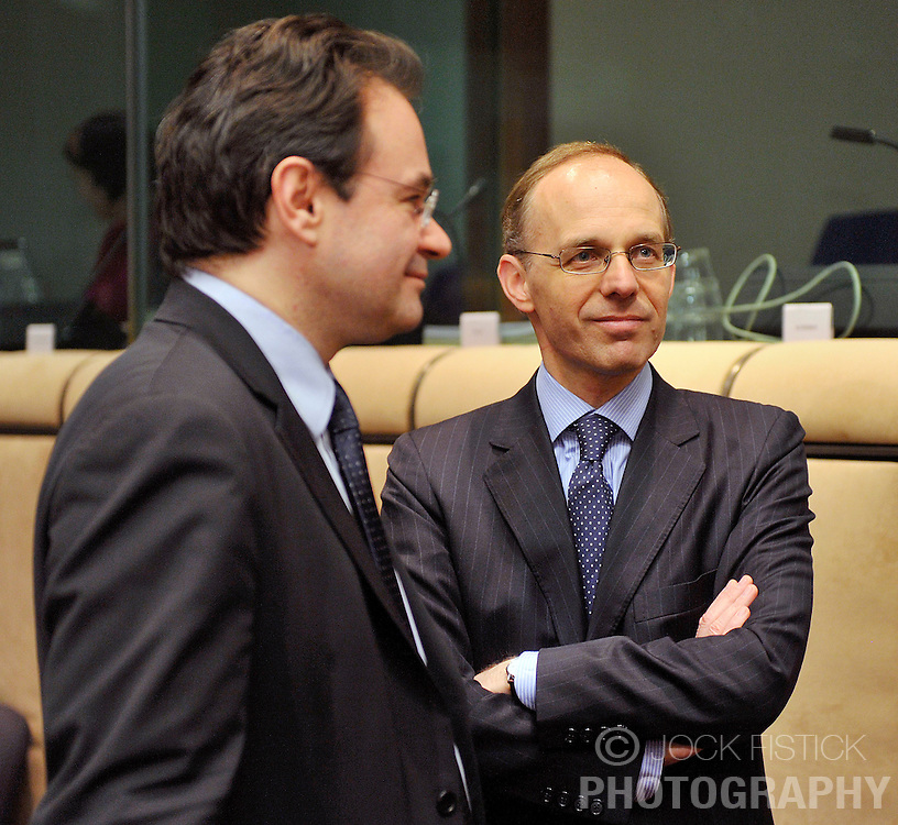 Luc Frieden, Luxembourg's finance minister, right, speaks with George Papaconstantinou, Greece's finance minister, during the Eurogroup meeting in Brussels, Monday Jan. 18, 2010. (Photo © Jock Fistick)