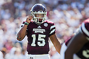 STARKVILLE, MS - SEPTEMBER 19:  Dak Prescott #15 of the Mississippi State Bulldogs at the line of scrimmage during a game against the Northwestern State Demons at Davis Wade Stadium on September 19, 2015 in Starkville, Mississippi.  The Bulldogs defeated the Demons 62-13.  (Photo by Wesley Hitt/Getty Images) *** Local Caption *** Dak Prescott