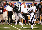 CANTON, OH - AUGUST 6:  Wide receiver Will Buchanon #13 of the Oakland Raiders reaches for an incomplete pass while defended by cornerback Matt Clark #22 of the Philadelphia Eagles during the AFC-NFC Pro Football Hall of Fame Game at Fawcett Stadium on August 6, 2006 in Canton, Ohio. The Raiders defeated the Eagles 16-10. ©Paul Anthony Spinelli *** Local Caption *** Will Buchanon;Matt Clark
