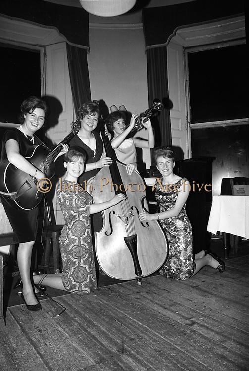 Irish Shell Christmas Party..1964..16.12.1964..12.16.1964..16th December 1964..the staff at Irish Shell Ltd held their annual Christmas party at The Salthill Hotel, Monkstown...Angela Rice, Phyllis Cronin, Margot McKenna, Jane Glynn and Mary Duggan are pictured taking over as the band break for a well deserved drink..