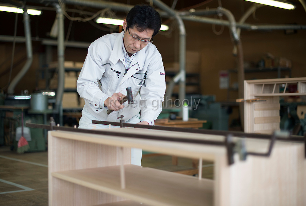 Takashi Fujita, 51, works on kiri-tansu furniture at Kamo Kiri-tansu maker Asakura Kagu in Niigata City, Niigata Prefecture Japan on Feb. 21, 2017. ROB GILHOOLY PHOTO