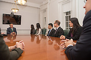 Grok program officers meet President Duane Nellis in Cutler Hall. Photo by Ben Siegel