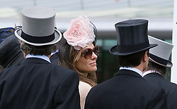 © licensed to London News Pictures.16/06/2011 Ascot, UK.  Liz hurley shares a joke with a friend after watching her horse Census fail to make a place on Ladies day at Royal Ascot races today (16/06/2011). The 5 day showcase event is one of the highlights of the racing calendar. Horse racing has been held at the famous Berkshire course since 1711 and tradition is a hallmark of the meeting. Top hats and tails remain compulsory in parts of the course. Photo credit should read: Ben Cawthra/LNP