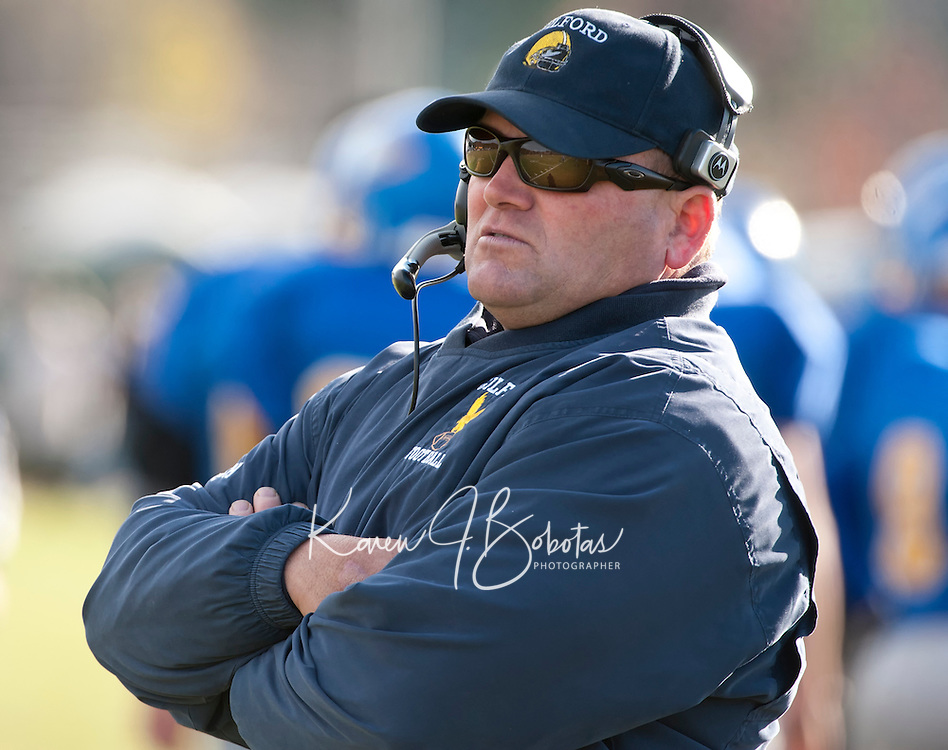 Gilford Eagles head coach Mark Brewer will take his team to the NHIAA Division VI state championship next Saturday on home turf at the Meadows Field against the Newport Tigers.  (Karen Bobotas/for the Laconia Daily Sun)
