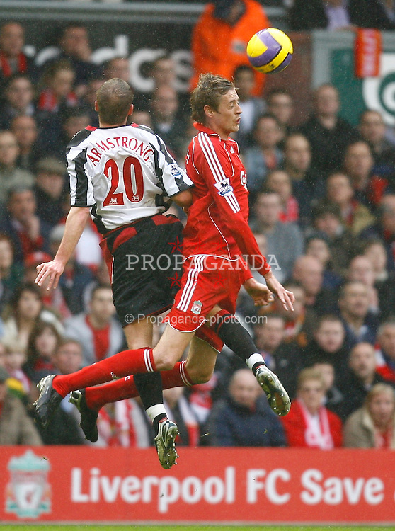 Liverpool, England - Saturday, February 24, 2007: Liverpool's Peter Crouch in action with Sheffield United's Chris Armstrong during the Premiership match at Anfield. (Pic by David Rawcliffe/Propaganda)