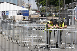 May 18, 2018 - Kiev, Ukraine - Workers stand during installation of a fan zone of the UEFA Champions League final in central Kiev, Ukraine, 18 May, 2018. The football UEFA Champions League final match between Real Madrid and Liverpool FC next May 26 at the NSC Olimpiyskiy Stadium. (Credit Image: © Str/NurPhoto via ZUMA Press)