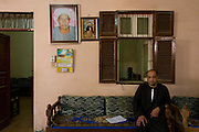 A portrait of regional MP Mohammed Yasim inside the community hall of the village of Qum on the West Bank of Luxor, Nile Valley, Egypt.