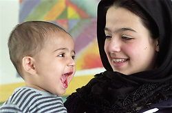 Mother with young son; laughing,