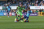 Forest Green Rovers Liam Noble(8) is tackled by Wycombe Wanderers Dominic Gape(4) during the EFL Sky Bet League 2 match between Wycombe Wanderers and Forest Green Rovers at Adams Park, High Wycombe, England on 2 September 2017. Photo by Shane Healey.