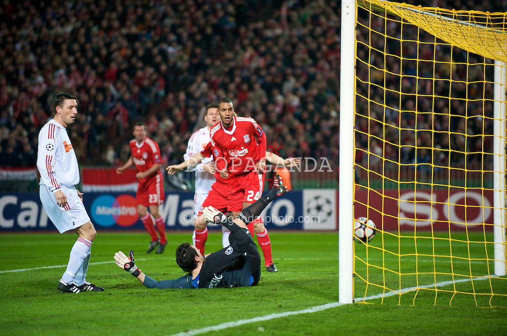 BUDAPEST, HUNGARY - Tuesday, November 24, 2009: Liverpool's David Ngog scores the opening goal past Debreceni's goalkeeper Vukasin Poleksic during the UEFA Champions League Group E match at the Ferenc Puskas Stadium. (Pic by David Rawcliffe/Propaganda)