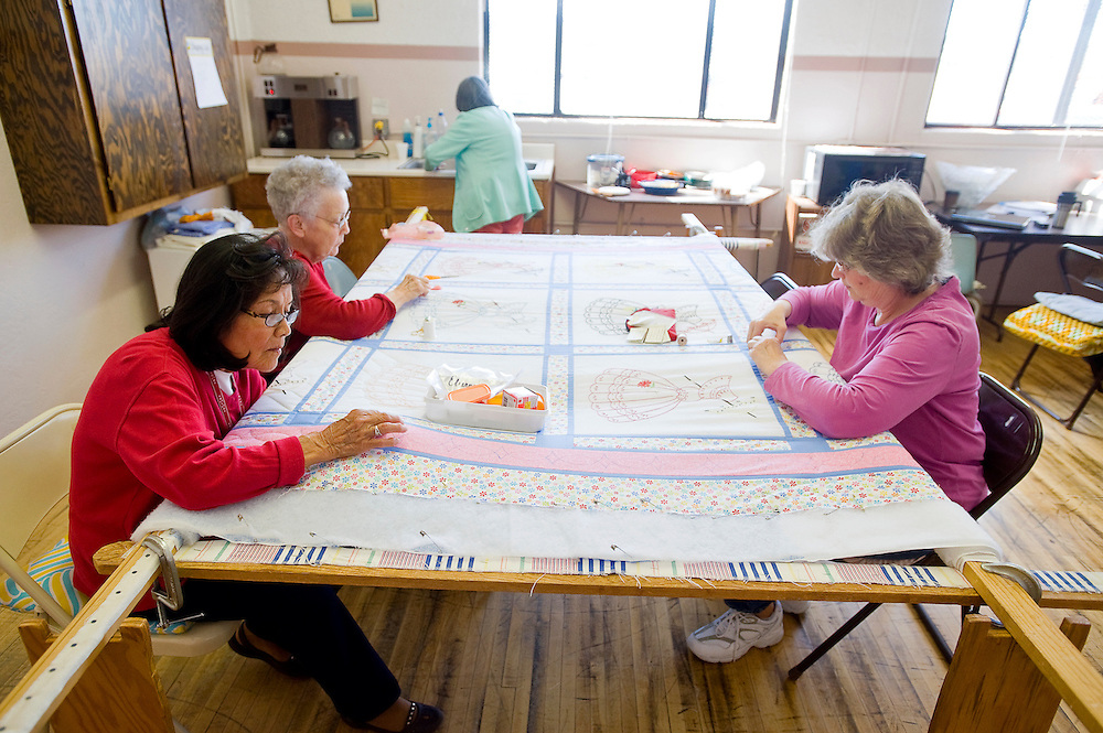 041912       Brian Leddy.Sylvia Conley (clockwise from left), Clara Orr and Sue Weaver work on a quilt during a Quilter's Guild meeting at the Larry Brian Mitchell recreation center Thursday. The guild is getting ready for a fundraiser on May 5, with the money raised going to charity.