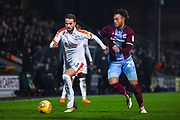 Andrew Shinnie of Luton Town (11) and Kyle Wootton of Scunthorpe United (29) rush to the ball during the EFL Sky Bet League 1 match between Scunthorpe United and Luton Town at Glanford Park, Scunthorpe, England on 26 December 2018.