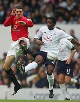 BARCLAYS PREMIERSHIP-25 SEPT-04-TOTTENHAM v Manchester Utd-PIC BY KIERAN GALVIN / COLORSPORT-John O'Shea plays footise with Mbulelo Mabizela.