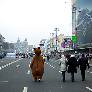 December 19, 2013 - Kiev, Ukraine: A man dressed as a bear walks by near Independence Square.<br /> On the night of 21 November 2013, a wave of demonstrations and civil unrest began in Ukraine, when spontaneous protests erupted in the capital of Kiev as a response to the government's suspension of the preparations for signing an association and free trade agreement with the European Union. Anti-government protesters occupied Independence Square, also known as Maidan, demanding the resignation of President Viktor Yanukovych and accusing him of refusing the planned trade and political pact with the EU in favor of closer ties with Russia.<br /> After a days of demonstrations, an increasing number of people joined the protests. As a responses to a police crackdown on November 30, half a million people took the square. The protests are ongoing despite a heavy police presence in the city, regular sub-zero temperatures, and snow. (Paulo Nunes dos Santos/Polaris)