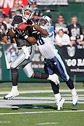 OAKLAND, CA - DECEMBER 19:  Wide receiver Jerry Porter #84 (caught 8 passes for 148 yards and 3 touchdowns) of the Oakland Raiders just misses catching a pass tipped by safety Lamont Thompson #28 of the Tennessee Titans at Network Associates Coliseum on December 19, 2004 in Oakland, California. The Raiders defeated the Titans 40-35. ©Paul Anthony Spinelli *** Local Caption *** Jerry Porter;Lamont Thompson