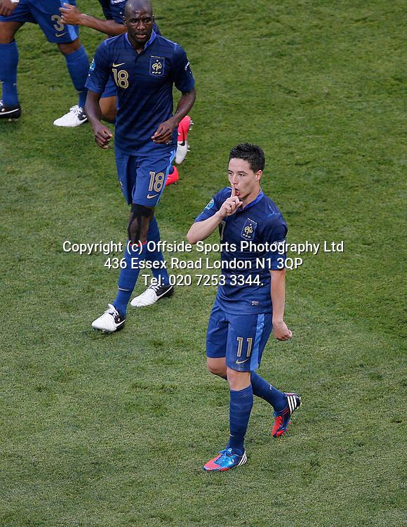 11/06/2012 European football championships. France v England.<br /> Samir Nasri gives a silence gesture towards the England bench.<br /> Photo: Mark Leech.