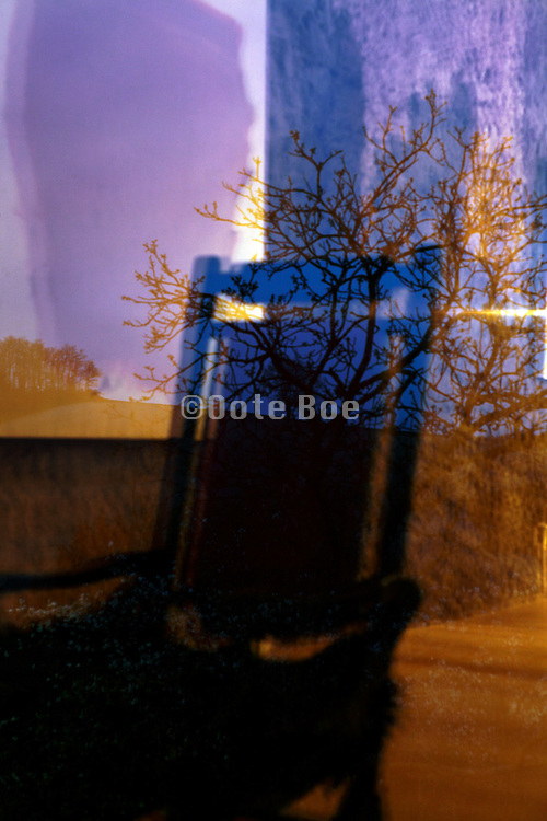 window with landscape and chair reflection