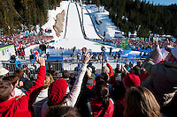 Fans cheer at Simon Ammann (SUI) wins the gold medal for the long-hill ski jump at the 2010 Olympic Winter Games in Whistler, BC Canada