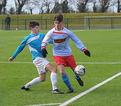 Colaiste Chiarain&rsquo;s Sean Ryan taking on the Summerhill College defence in the FAI U19 Schools final.<br />Pic Conor McKeown