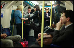 The Prime Minister on the Tube on his way back to his office No10 Downing Street after a visit in East London, London Thursday October 6, 2011. Photo By Andrew Parsons / i-Images.