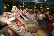 Passengers having fun at the crew show in the Panoramasalon...M.S. Johann Strauss, a brand new four star+ river cruiser operated by Austrian River Cruises, and chartered by Club 50 (a travel agency especially for seniors aged 50 and up) undertook an epic 3-week journey (May 21 to June 10, 2004) all the way from Amsterdam to the Black Sea?along Rhine, Main and Danube?, presumably the first passenger vessel ever to have done so. This is one of the images recorded during this historic voyage.