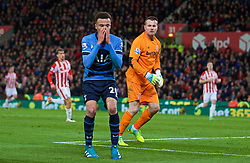 STOKE-ON-TRENT, ENGLAND - Monday, April 18, 2016: Tottenham Hotspur's Dele Alli looks dejected after missing an open goal against Stoke City during the FA Premier League match at the Britannia Stadium. (Pic by David Rawcliffe/Propaganda)