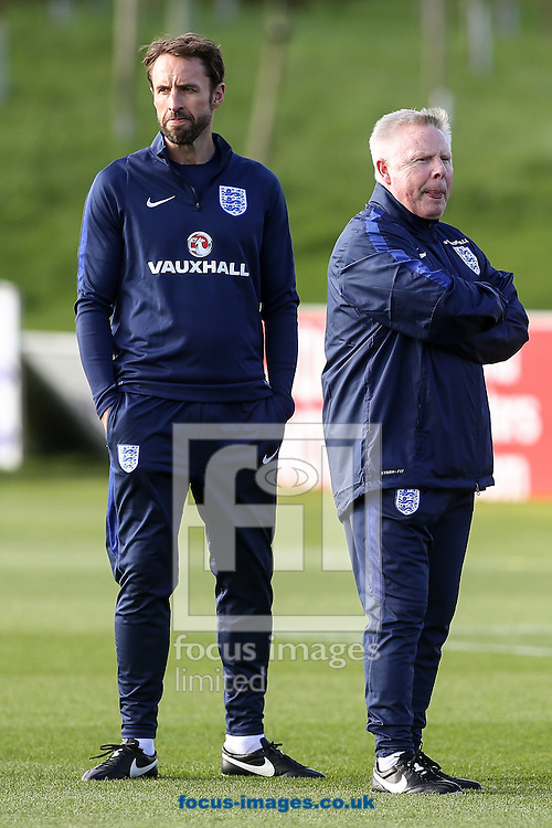 Gareth Southgate, caretaker England manager, (left) with Sammy Lee assistant manager during the England training session at St Georges Park, Burton upon Trent<br /> Picture by Andy Kearns/Focus Images Ltd 0781 864 4264<br /> 04/10/2016