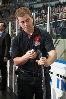 KELOWNA, CANADA - NOVEMBER 7: Brendan Hait, equipment manager of the Kelowna Rockets waxes a stick on the bench against the Spokane Chiefs on November 7, 2014 at Prospera Place in Kelowna, British Columbia, Canada.  (Photo by Marissa Baecker/Shoot the Breeze)  *** Local Caption *** Brendan Hait;