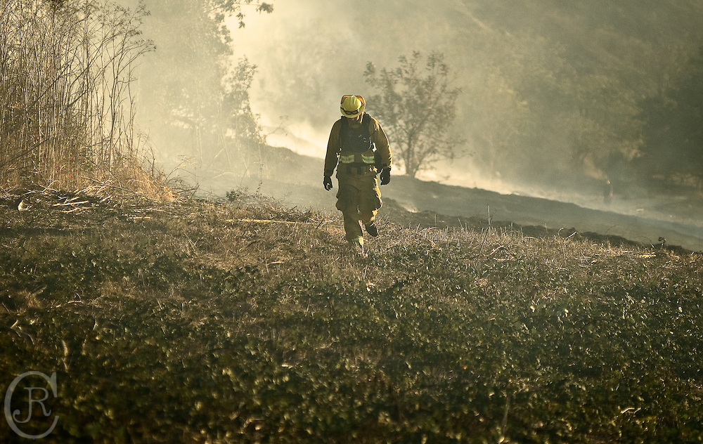 Fire Fighter walks through the fires damage.