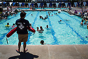 Dozens of lifeguards supervise the swimmers during the Waving the Red, White & Blue Pool Party at the Milpitas Sports Center in Milpitas, California, on July 4, 2014. (Stan Olszewski/SOSKIphoto)