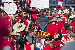 April 27, 2018 - Phoenix, Arizona, U.S - Educators and supporters gather during the second day of school walkouts on Friday, April 27, 2018, at Arizona State Capitol in Phoenix, Arizona. Teachers, counselors and other school staff have been rallying for increased education funding under the hashtag #RedForEd. (Credit Image: © Ben Moffat/via ZUMA Wire via ZUMA Wire)