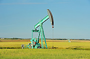 Oil pump jack and oats<br /> Carlyle<br /> Saskatchewan<br /> Canada