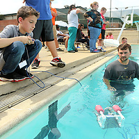 "Keith Gallardo, 12, of Corinth, pilots the SeaPerch Robot as Austin Beasley, a Student Navigator for ""Tiger Tech Camp"", helps guide him through an underwater obstacle course in the pool at Northeast Community College on Wednesday afternoon in Booneville. The SeaPerch Robot is a Naval funded program for Northeast with ""Tiger Tech Camp"" teaching coding, lego robotuce, IPad 101, 3D printing and other technologies."