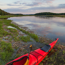 A kayak on the shore of the North River in Marshfield, Massachusetts. Near Emilson Farm.