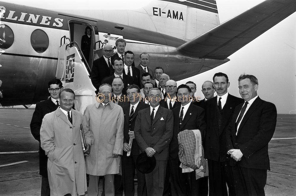 19/09/1963<br /> 09/19/1963<br /> 19 September 1963<br /> Massey Ferguson group departing Dublin for Paris Factory visit. A party of 23 executives of Massey Ferguson (Eire) Ltd. and dealers went on a three day visit to the Massey Ferguson factory at Beauvais, Paris as guests of Massey Ferguson France. Picture shows members of the group about to board their flight at Dublin Airport including Mr. M. Henderson, Director and General Manager, Massey Ferguson (Eire) Ltd.; Mr. J.J. McCormick, Retail Sales Manager and Mr. J. O'Connor, Service Manager.