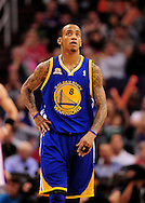Feb. 22, 2012; Phoenix, AZ, USA;  Golden State Warriors guard Monta Ellis (8) reacts on the court against the Phoenix Suns at the US Airways Center.  The Warriors defeated the Suns 106 - 104. Mandatory Credit: Jennifer Stewart-US PRESSWIRE.