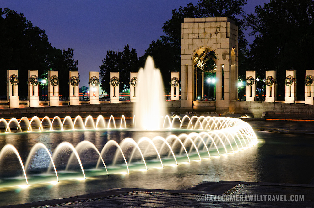 Night shot of the fountains at center of the National World War II Memorial in Washington DC