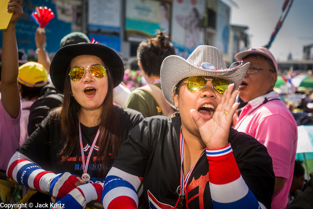 """13 JANUARY 2014 - BANGKOK, THAILAND: Anti-government protestors cheer during a rally in front of MBK shopping center in Bangkok. Tens of thousands of Thai anti-government protestors took to the streets of Bangkok Monday to shut down the Thai capitol. The protest was called """"Shutdown Bangkok"""" and is expected to last at least a week. The Shutdown Bangkok protest is a continuation of protests that started in early November. There have been shootings almost every night at different protests sites around Bangkok, including two Sunday night, but the protests Monday were peaceful. The malls in Bangkok stayed open Monday but many other businesses closed for the day and mass transit was swamped with both protestors and people who had to use mass transit because the roads were blocked.    PHOTO BY JACK KURTZ"""