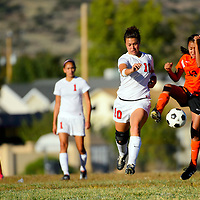 100113  Adron Gardner/Independent<br /> <br /> Grants Pirate Brianna Fank (10), left,  and Gallup Bengal Jennifer Hudson (13) leap for a bouncing ball in Grants Tuesday.