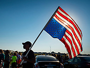 17 JUNE 2020 - NORWALK, IOWA: A member of Black Lives Matter carries an upside down American flag during a Black Lives Matter protest in Elizabeth Holland Park. About 400 supporters of Black Lives Matter marched through Norwalk, IA, an upper class suburb of Des Moines Wednesday. Norwalk has a population of about 10,000 and, according to the US Census Bureau, is 97 percent white. The marchers were protesting police violence against people of color. The march was a reaction to the police killing of George Floyd in Minneapolis in May. The march was peaceful.         PHOTO BY JACK KURTZ