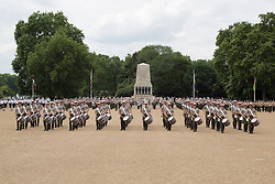 © Licensed to London News Pictures. 02/06/2014. London, UK. The Royal Marines band, with colleagues form the Netherlands and the United States take part in a dress rehearsal for Beating Retreat on Horse Guards Parade in Whitehall, London on 2nd June 2014. The military event is performed every two years in celebration of the birthday of the Captain General of the Royal Marines, the Duke of Edinburgh and this year forms part of a schedule of UK-wide celebrations to mark the 350th anniversary of the Royal Marines. Photo credit : Vickie Flores/LNP
