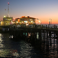 Santa Monica Pier, Los Angeles, California, just after sunset. Santa Monica Pier is also the western end of the famous Route 66.