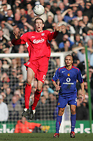Photo: Lee Earle.<br /> Liverpool v Manchester United. The FA Cup. 18/02/2006. Liverpool's Peter Crouch (L) is watched by Wes Brown.