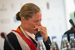 Adelinde Cornelissen (NED)<br /> breaking down emotionally at the press conference after winning the bronze medal<br /> PSI FEI European Championships Dressage - Herning 2013<br /> © Hippo Foto - Jon Stroud