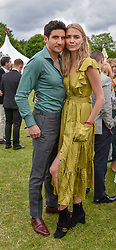 Jodie Kidd and Joseph Bates at the Cartier Queen's Cup Polo 2019 held at Guards Polo Club, Windsor, Berkshire. UK 16 June 2019. <br /> <br /> Photo by Dominic O'Neill/Desmond O'Neill Features Ltd.  +44(0)7092 235465  www.donfeatures.com