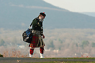 West Point, New York - A pipe and drum performer walks away at the end of the 32nd annual West Point Military Tattoo at Trophy Point at the United States Military Academy on April 13, 2014.