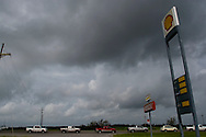 Cars wait in line for a gas station to open in the wake of Hurricane Gustav, Wednesday September 3 ,2008