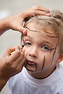 Alex Bubnack, 4, gets his face painted.