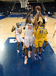 Virginia center Aisha Mohammed (33) grabs a rebound from UCSB forward Ashlee Brown (23).  The #4 seed/#24 ranked Virginia Cavaliers defeated the #13 seed Santa Barbara Gauchos 86-52 in the first round of the 2008 NCAA Division 1 Women's Basketball Championship at the Ted Constant Convocation Center in Norfolk, VA on March 23, 2008